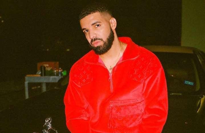 Drake posing in red